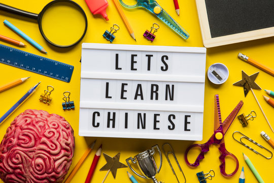 Lets learn chinese lightbox message on a bright yellow background
