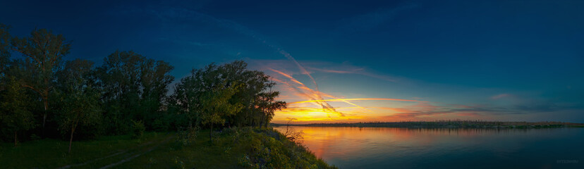 """Sunset with traces of aircraft in the natural park """"Donskoy"""". Volgograd region. Russia"""