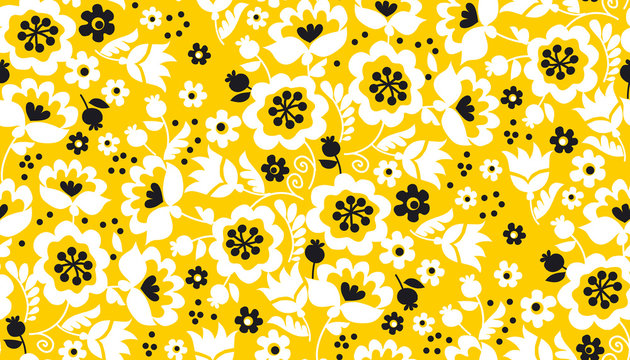 Simple yellow flower seamless pattern. Naive summer bright gold floral repeatable motif. Fabric rapport with black and white decorative flowers.