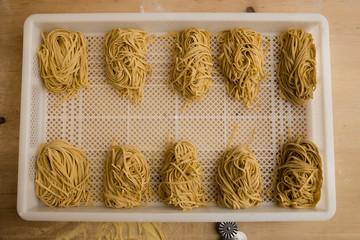 Obraz Overhead shot of rows of freshly made pasta. - fototapety do salonu