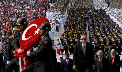Turkish President Tayyip Erdogan attends a ceremony marking the 96th anniversary of Victory Day at the mausoleum of Mustafa Kemal Ataturk in Ankara