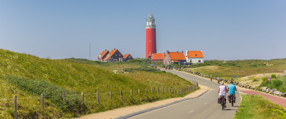 Panorama of a couple on bicycles on Texel Island, Netherlands Wall mural