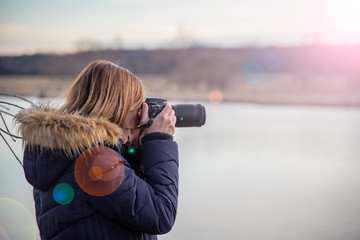 nature photographer holding camera