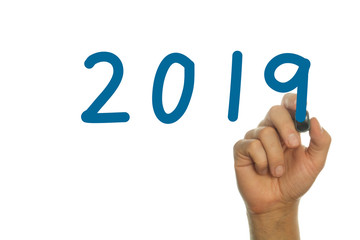 hand writing the word year 2019 in blue handwritten letters
