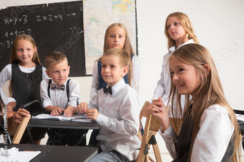 school children in classroom at lesson the little boys and girls