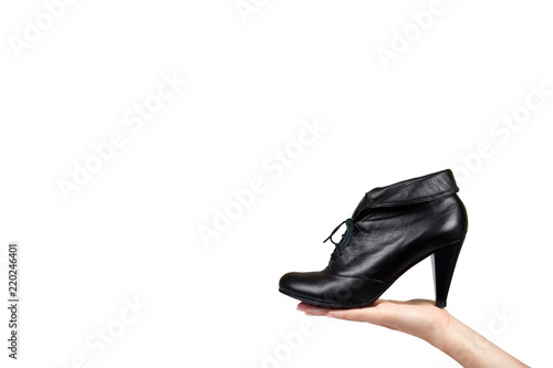 female black leather high heel shoes with hand isolated on white
