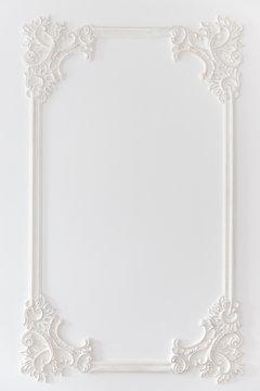 Decoration molding frame item made of white plaster. Relief stucco interior