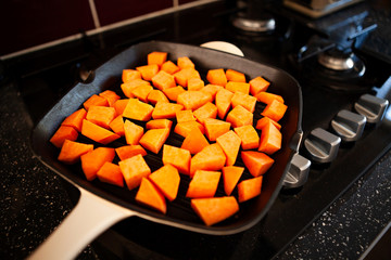 Sweet potato being cooked in a griddle pan/broiler