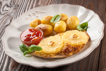 Grilled chicken fillet with pineapples and baked potatoes