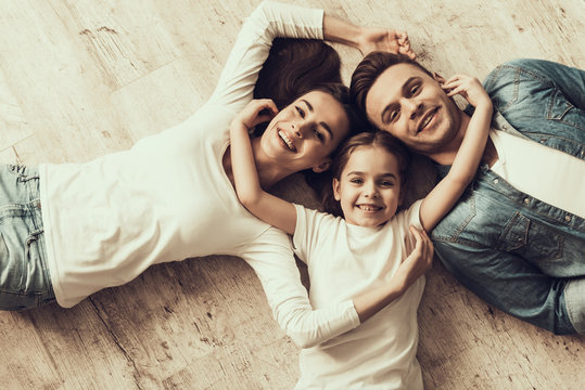 Happy Family Lying of Floor Together at Home
