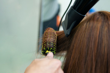 Hair coloring and curly perm setting styling at salon makes hair damaged and coarse