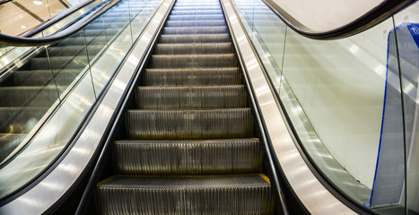 Closeup mechanical escalators for people up and down faster and quick. Access detail. Escalator in community mall, shopping center, plaza, airport or metro. Modern escalator electronic system moving.