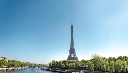 Panoramic view of Eiffel Tower and Seine river with puffy clouds, Paris, France