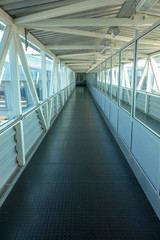 Gangway from gate to ship.