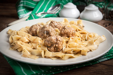 Tagliatelle pasta with beef meatballs.