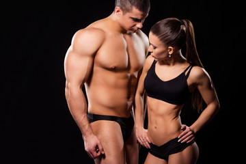 Attractive girl and big bodybuilder.