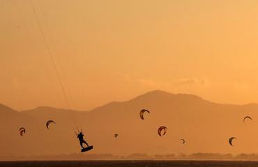Kite surfers are seen on Barra da Tijuca beach in Rio de Janeiro