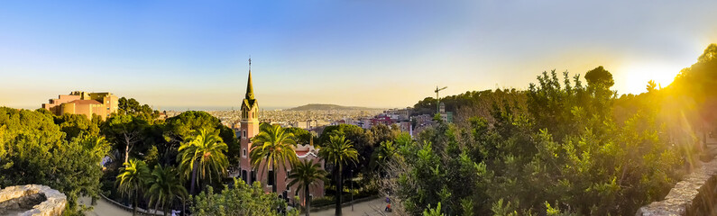 View of the city from Park Guell in Barcelona, Spain with sunrise colors