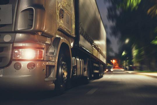 truck speeding by night road