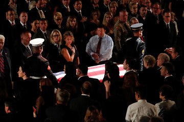 An honor guard carries the casket of Senator John McCain into the North Phoenix Baptist Church for a memorial service in Phoenix