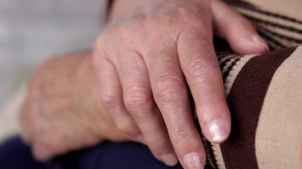 Aging process - old senior woman hands wrinkled skin