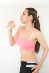 Exercise concept. Athletes are tired of exercising. Beautiful girl drinking water after exercise.