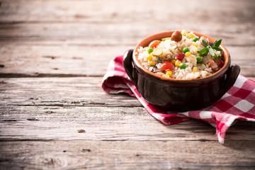 Traditional italian rice salad on wood table