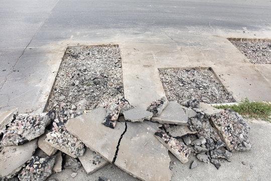 bad asphalt road, repair of asphalt road,  pit on the road
