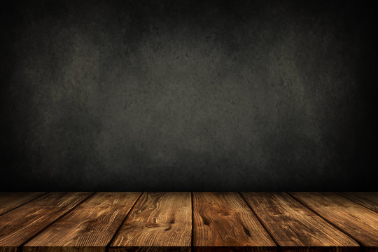wooden table with grey wall background