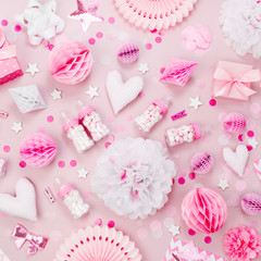 Pink and white Paper Decorations, pom-pom, candy, hearts, gifts, confetti for Baby party. Birthday concept.  Flat lay, top view