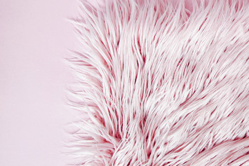Pink fluffy fur background.  Flat lay, top view