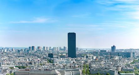 Aerial panoramic view of Montpernasse skyscraper and Paris skyline in sunny day