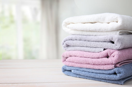 Towels stack on table empty space background.