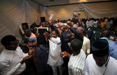 Political activists who aspire to political officetake a group selfie after Nigeria's Senate leader, Bukola Saraki, announced that he would stand to become the main opposition candidate in 2019's presidential elections in Abuja