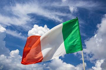 Italian flag waving in the blue sky