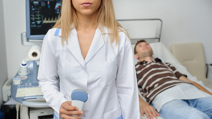 The doctor using the ultrasonography device