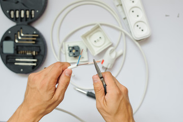 The work process of an electrician