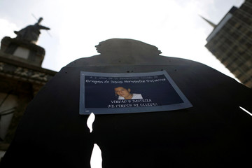 A picture of a missing person is pictured during a demonstration to mark International Day of the Victims of Enforced Disappearances in Mexico City