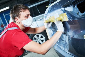 auto repairman grinding automobile body Wall mural