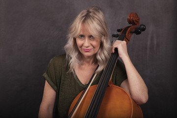 Blonde Woman with Cello on a Chalk Background