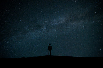 The man standing on the background of stars