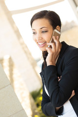Business woman talking on her mobile phone. outside an office bussiness.