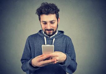 Happy beard hipster man using a smartphone