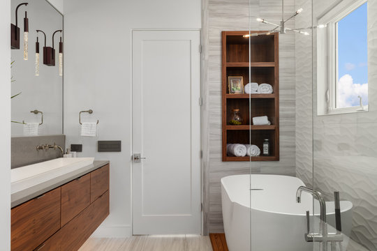 modern white and wood master bathroom with bath and shower