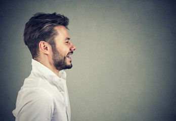 Profile of handsome smiling man