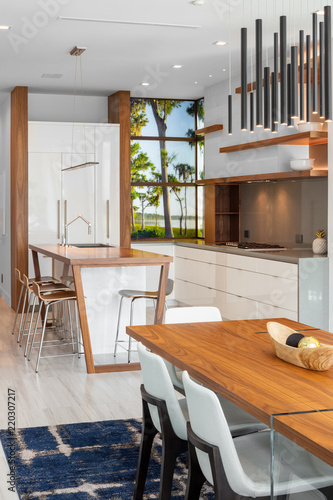 Modern White Kitchen And Dining Room With Wood Breakfast Bar