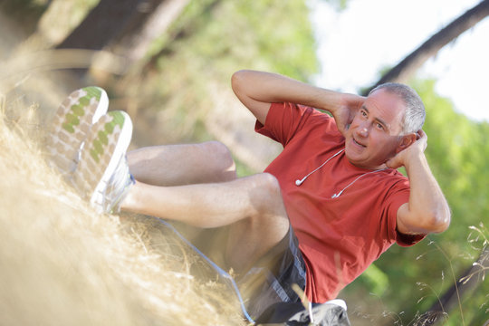 middle-aged man working out outside