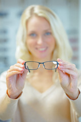 Woman trying on a pair of glasses