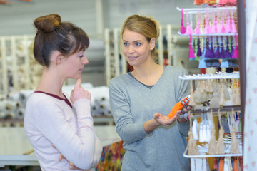 young brunette female buying cosmetics for hair