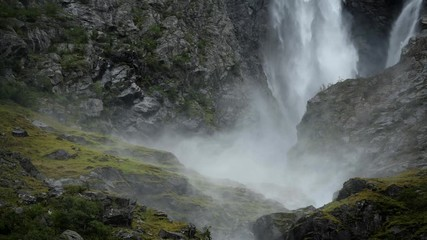 Wall Mural - Glacial Waterfall Closeup. Large Scenic Waterfall in Norway.